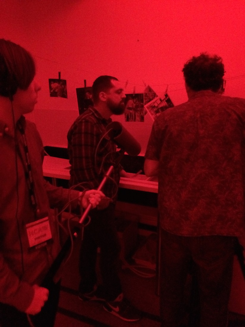Filming in the Hereford College of Art Darkroom with a student and volunteer