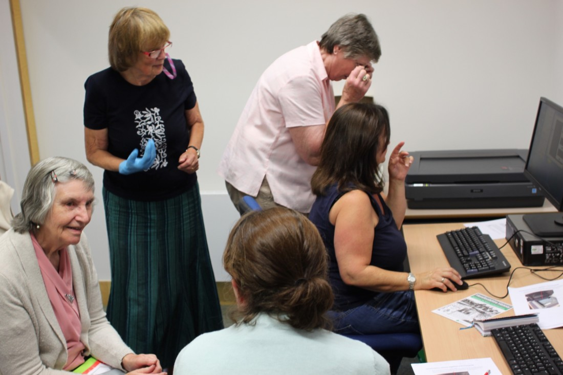 Volunteers training to digitise Derek Evans negatives in August 2017