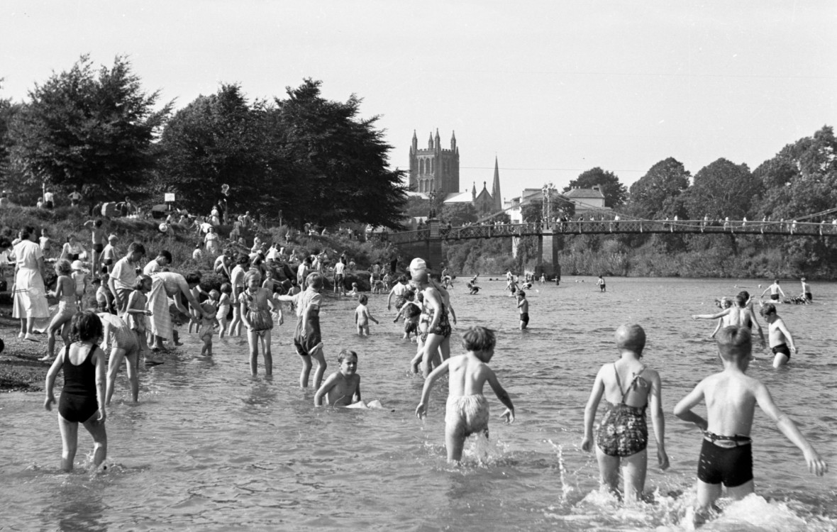 Children play in the river Wye near Victoria Bridge