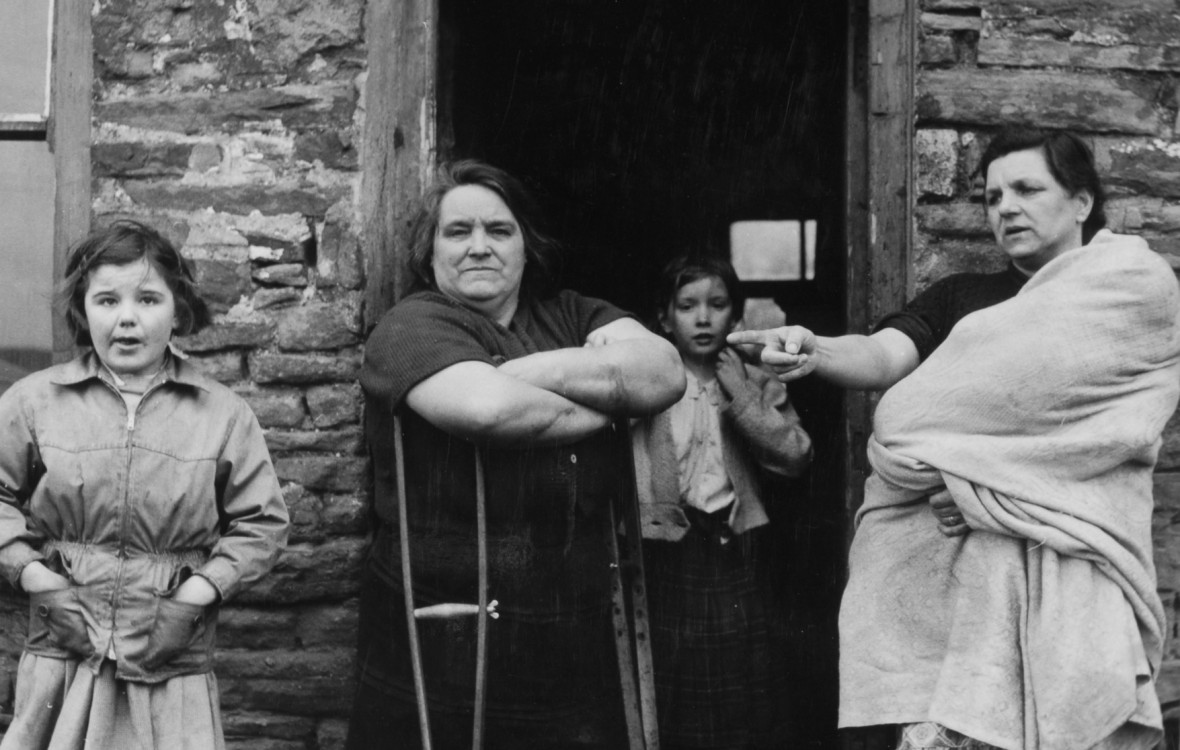 Family outside their home in a Welsh mining village