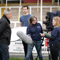 Edgar Street filming - Volunteer Cameron assists Catcher filming Nick Nenaditch