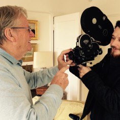 Keith James demonstrates old 16mm news camera to out Film Making Intern, Michael Kenny