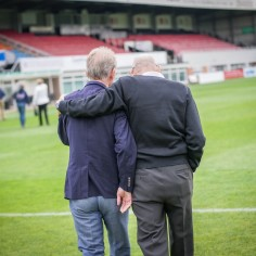 Ronnie Radford and Colin Addison on the pitch at Edgar Street, reminiscing about beating Newcastle in 1972