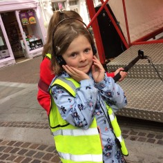 A pupil monitors sound filming Mayfair