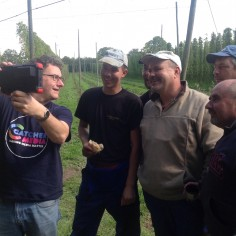 Polish hop pickers watch themselves on film