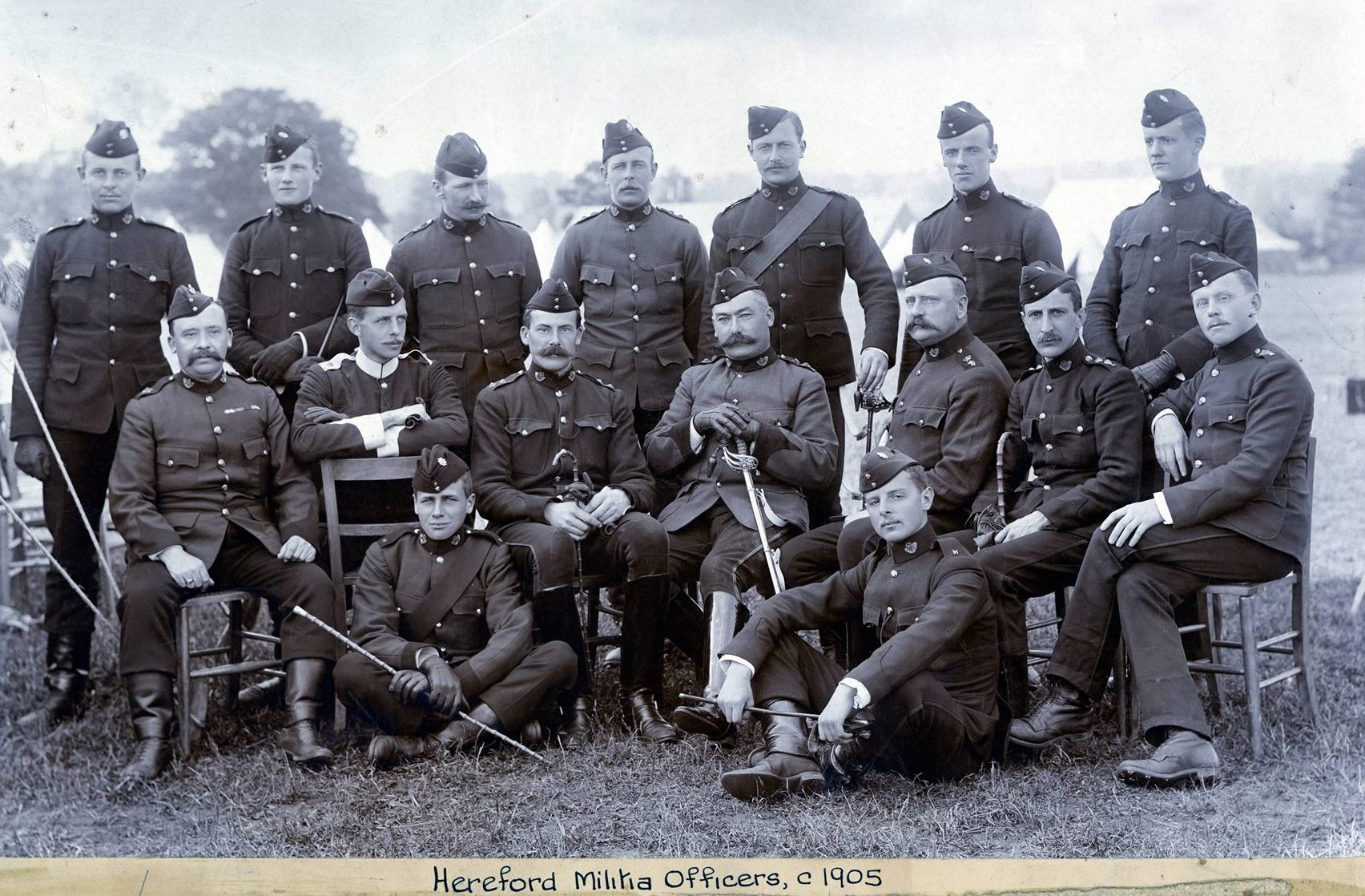 Oliver is sat next to Col. Symonds-Taylor of the Kings Shropshire Light Infantry